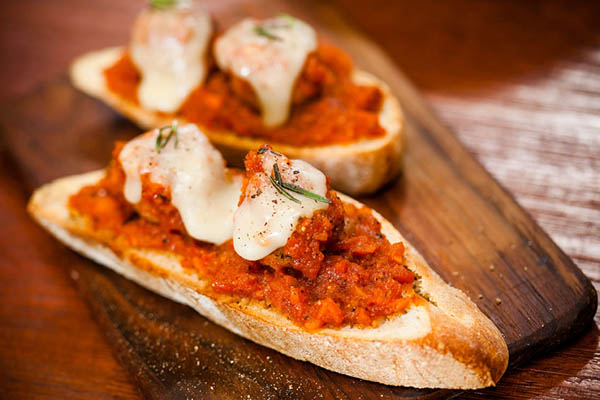 Meatballs and house marinara on crostini